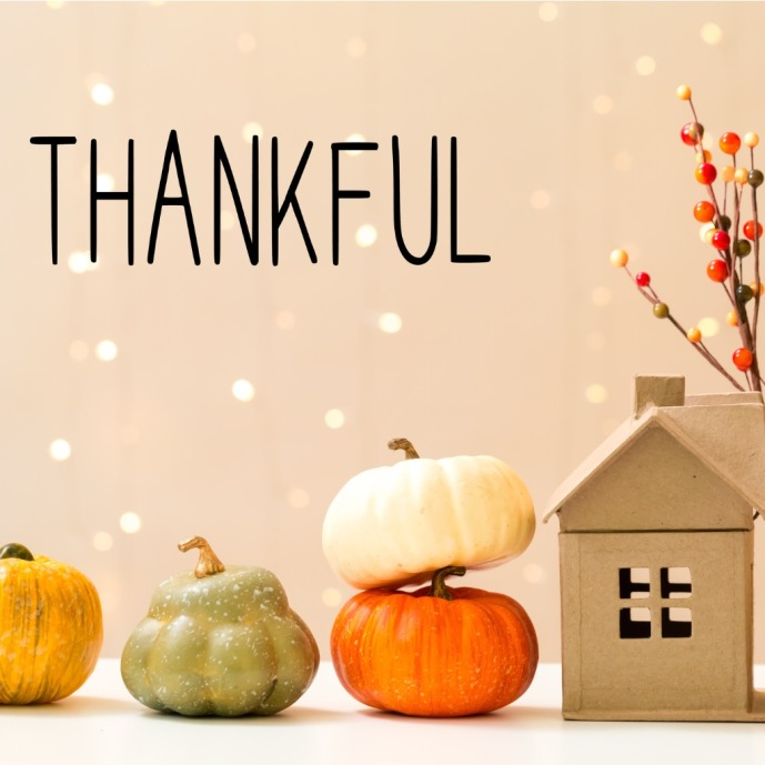 thankful-message-with-pumpkins-with-a-house-picture-id1173881410.jpg